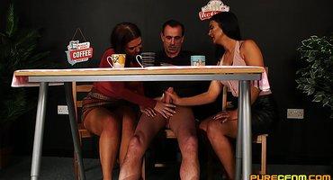 Две девки в кафе подрочили мужику под столом крепкий член